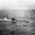 A U.S. Navy HSS-1 Seabat helicopter hovers over Soviet submarine B-59, forced to the surface by U.S. Naval forces in the Caribbean near Cuba (October 28–29, 1962)